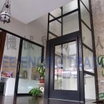 black glass platform lift on ground floor