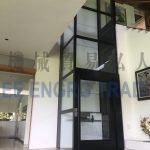 multi storey black glass platform lift