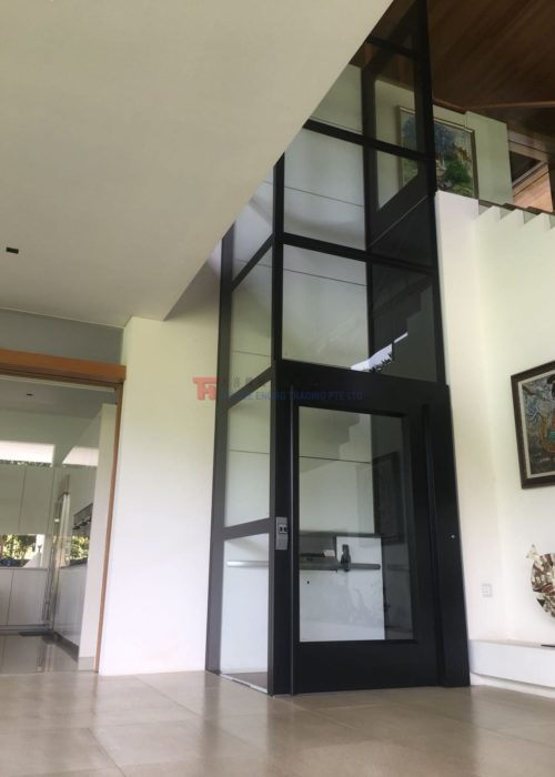multi storey black glass platform lift